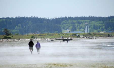A senior couple walking at beach near Oak Harbor, Deception Pass Park, Washington Stock fotó