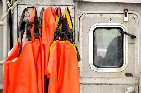 Orange fisher overalls hanging on fisher boat in Willapa Bay Zdjęcie Seryjne