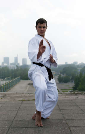 karate poses against the backdrop of the city photo