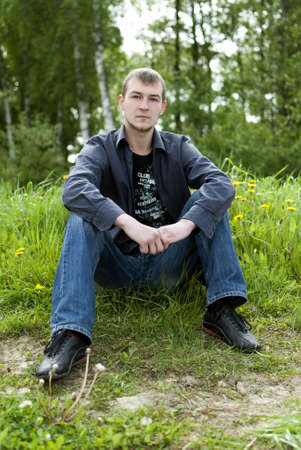 man sitting in the woods and looking at the camera Stock Photo - 10029323