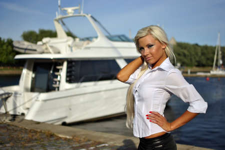 portrait of blonde girl in a white shirt against the boat Stock Photo - 10225917