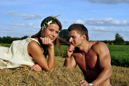 bodybuilder with a cute girl in the countryside photo