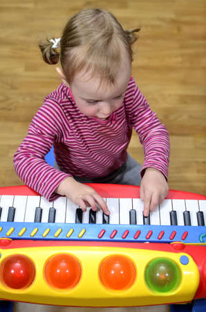 playing piano: little girl playing the piano