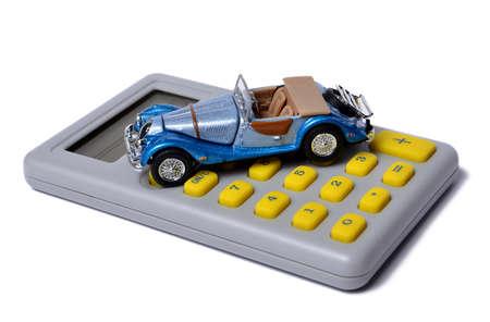 miniature minivan on a calculator isolated on white, concept Stock Photo - 11170524