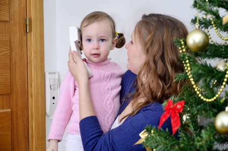 christmas call. mother and child calling by the phone at the christmas photo
