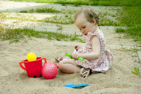 sandpit: little girl playing in the sandbox