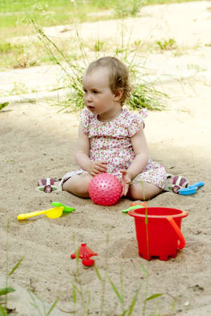 little girl playing in the sandbox Stock Photo - 11235212