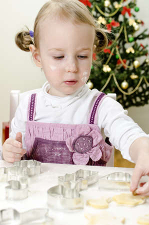 little cute girl making Christmas cookies Stock Photo - 11413224