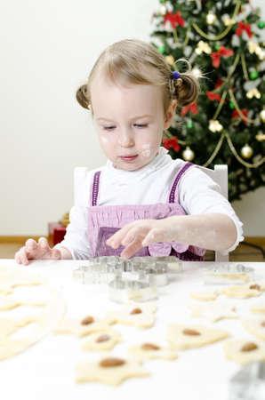 little cute girl making Christmas cookies Stock Photo - 11413210