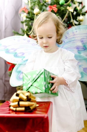 little girl holding christmas gift photo