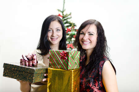 Christmas: Two girls with gifts photo