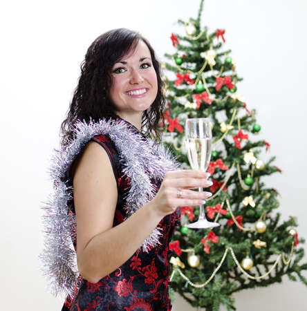 Christmas: girl congratulates with glass of wine photo