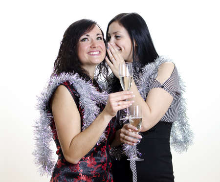 two girls gossiping at the party photo