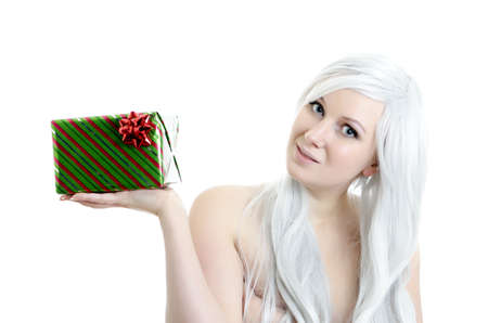 attractive blond girl holding gift in hand isolated on white bachground photo