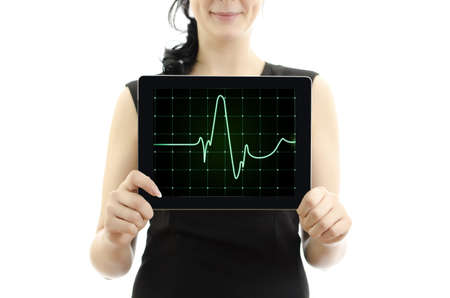 Woman holding tablet pc. Concept: cardiogram with heartbeat. isolated on white. photo