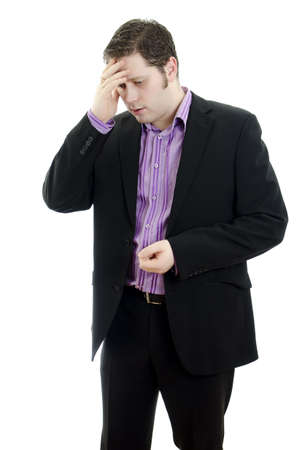 Portrait of a young business man looking depressed from work. Isolated over white background photo