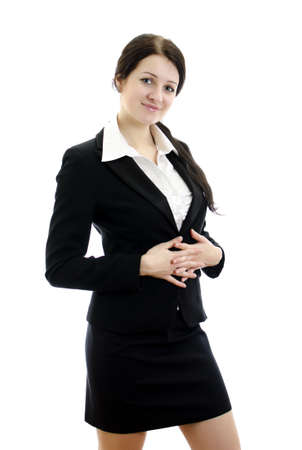 Portrait of a young attractive business woman with hands folded. Isolated on white. photo