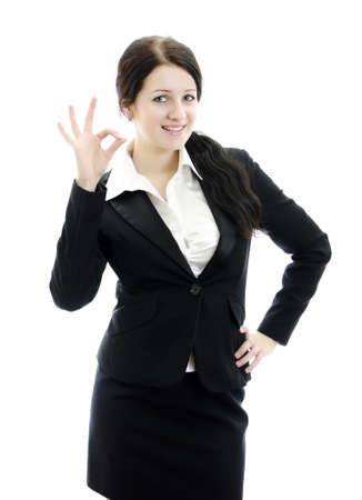Portrait of business woman gesturing okay sign. Isolated on white. photo