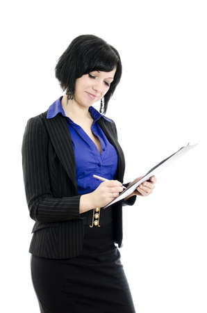 Portrait of a business woman signing document. Over white background. photo