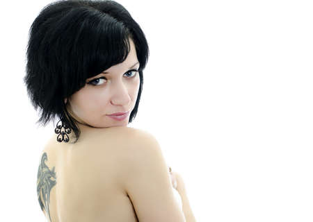 Close-up portrait of brunette woman with tattoo, isolated over white background photo
