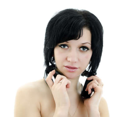 Close-up portrait of brunette woman with headphones, isolated over white background photo
