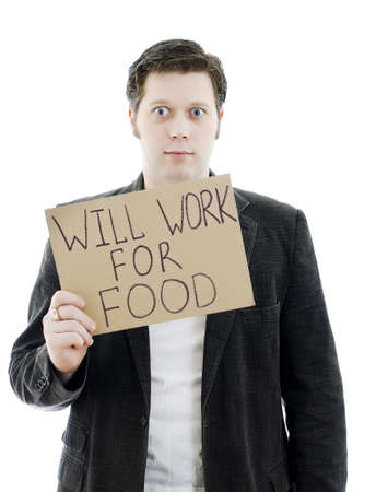 Unemployed businessman with a sign WILL WORK FOR FOOD. Isolated on white. photo
