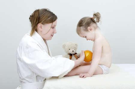 Therapist makes a child massage  photo