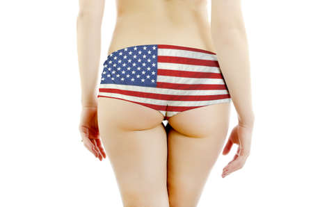 Beautiful female ass in USA panties. Isolated on white background. photo