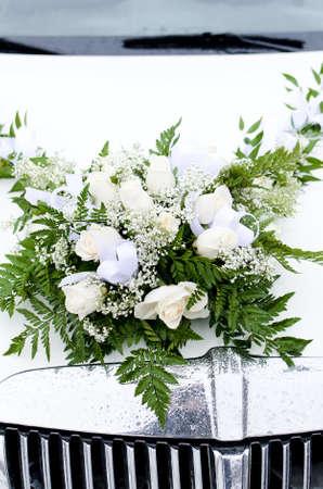 Bridal bouquet on the Car hood photo