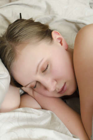 sleeping pad: Young girl sleeps in the bed under the covers