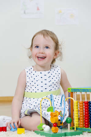 Little girl playing in a developing toy Stock Photo - 13145979