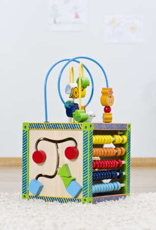 Developing toy is standing on the floor in children room photo