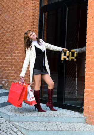 Portrait of pretty girl with shopping bags photo