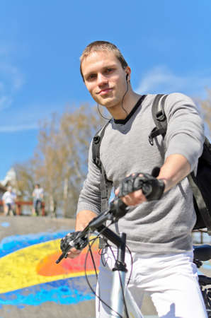 Portrait of  bicycle rider on urban skatepark background photo
