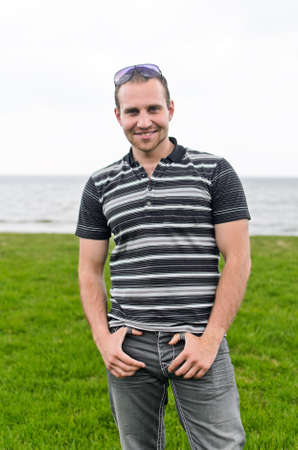 Handsome smiling man near the seaside. Stock Photo - 13559110