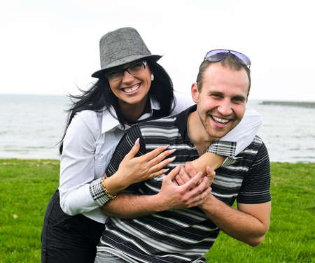 Portrait of a smiling couple by the sea Stock Photo