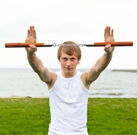 nunchaku: Martial arts: Man with nunchaku  Stock Photo