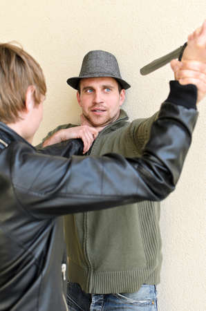 Burglar is trying to kill man by knife. photo