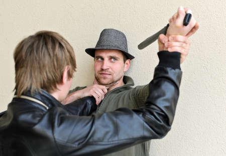 Burglar is trying to kill man by knife. Stock Photo - 13559242