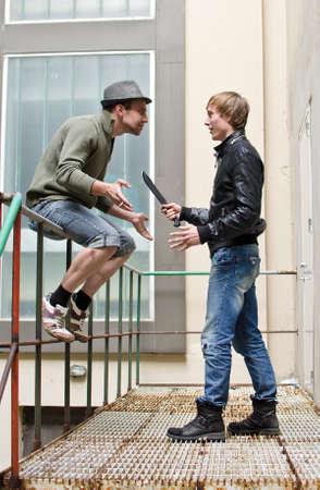Mafia. Conversation between two street thugs. Stock Photo - 13559188