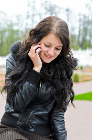 Attractive girl calling by the phone. photo