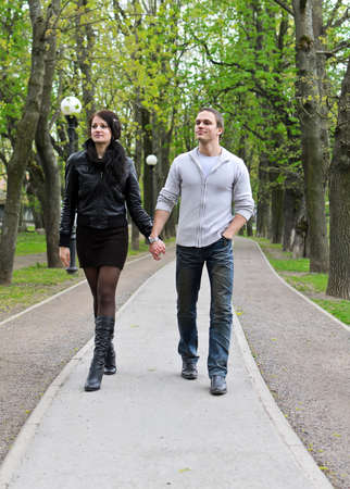 2 way: Couple walking down the road in the park  Stock Photo