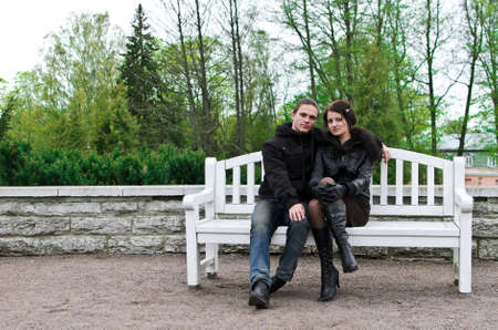 Portrait of happy couple on park bench  photo