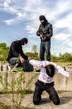 Two masked gunman trying to kill businessman Stock Photo - 13758909