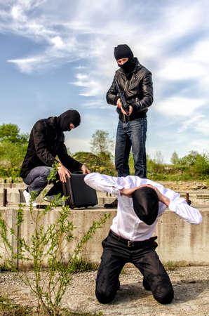 Two masked gunman trying to kill businessman Stock Photo - 13758909