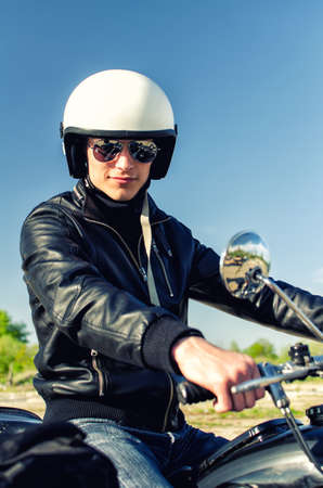 Motorcycle cop in a helmet and goggles photo
