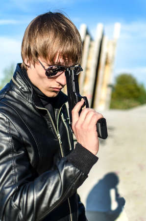 Portrait of man with a gun in glasses Stock Photo - 13758846
