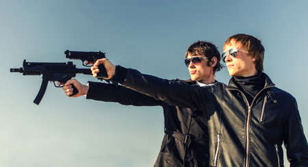 Portrait of two tough guys with guns photo