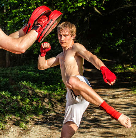 thai kick boxing: Two man training Muay thai in forest Stock Photo