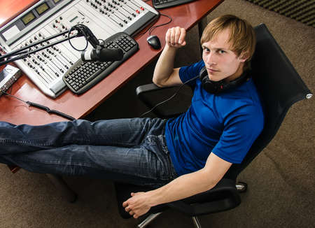 radio dj: Dj working in front of a microphone on the radio, from the top